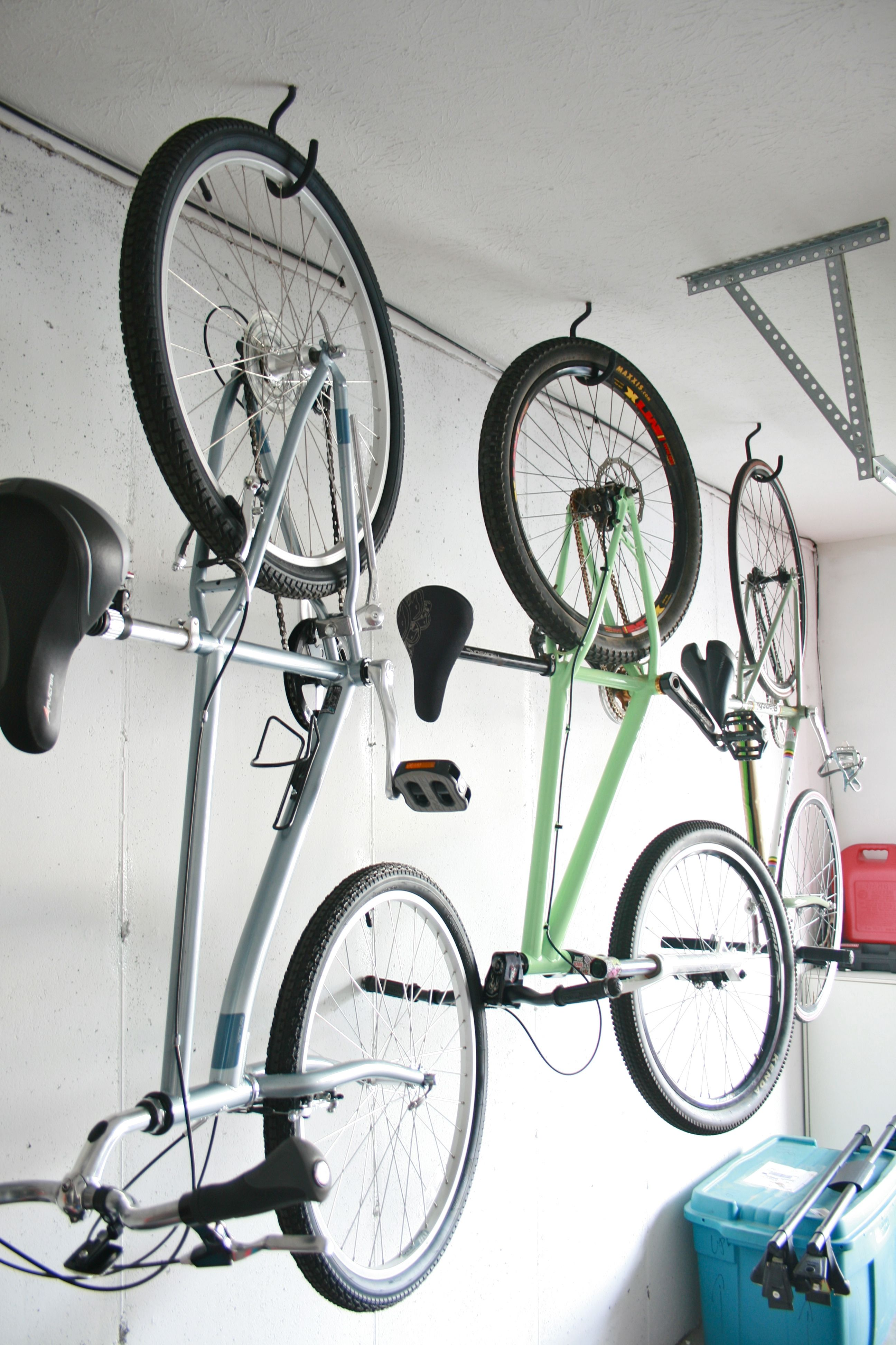 If you have multiple bikes and are hanging them by the wheels, you can alternate front and rear wheel hanging so the handlebars don't get in the way of each other. Hoist bike storage is a nice alternative to the standard ceiling rack, and ideal for high ceilings when you can't easily reach your bike on a standard hook or mount. Hoists raise your bike up and out of the way so you can free up space in your garage, .